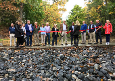 State and local representatives and FOGP Board members commemorate the completion of the restoration project.