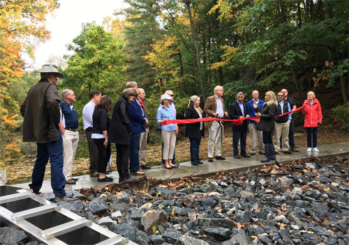 Joined by First Selectman Jayme Stevenson, State Rep Terrie Wood and State Senator Carlo Leone, FOGP Board members commemorate the completion of the restoration project.