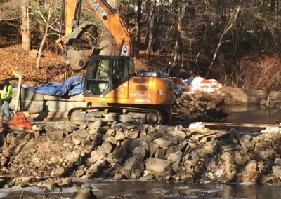 Removing broken dam